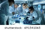 team of medical research... | Shutterstock . vector #691541065