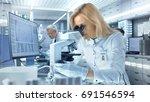 female research scientist looks ... | Shutterstock . vector #691546594