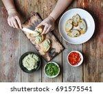 preparation of bruschetta.... | Shutterstock . vector #691575541