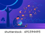 young man sitting in the park... | Shutterstock .eps vector #691594495