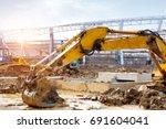 the excavator is working... | Shutterstock . vector #691604041
