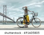blonde woman in summer hat and... | Shutterstock . vector #691605805
