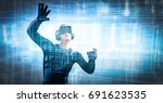 into virtual reality world. man ... | Shutterstock . vector #691623535