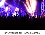 rear view of crowd with arms... | Shutterstock . vector #691623967