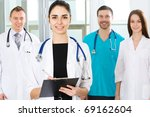 female doctor standing with... | Shutterstock . vector #69162604