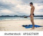 full body shot of a handsome... | Shutterstock . vector #691627609