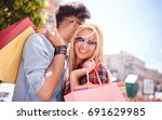 beautiful young couple enjoying ... | Shutterstock . vector #691629985