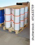 Small photo of Packed cargo pallet with white plastic buckets