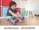 cute little kid sitting next... | Shutterstock . vector #691635049