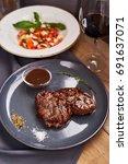 slice of grilled beef steak... | Shutterstock . vector #691637071