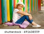 girl in hat and jeans in park | Shutterstock . vector #691638559