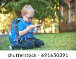 cute clever boy in glasses with ...   Shutterstock . vector #691650391