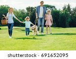 happy young family with two...   Shutterstock . vector #691652095