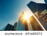 skyscraper glass facades on a... | Shutterstock . vector #691685071