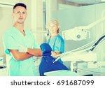 portrait of professional male... | Shutterstock . vector #691687099