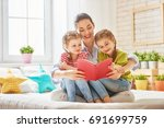 happy loving family. pretty... | Shutterstock . vector #691699759