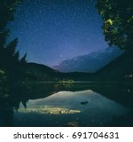 mountain lake synevir at night... | Shutterstock . vector #691704631