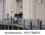 Small photo of Chicago, IL, August 5, 2017: People wait in line for the Wendella water taxi at the Ogilvie stop, the last stop downtown before Chinatown, a popular destination that attracts many daily visitors.