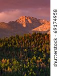 Small photo of Colorado's famous Longs Peak bathed in Alpenglow of the morning sunrise