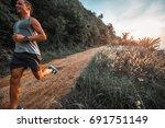 athletic happy man runs on a... | Shutterstock . vector #691751149