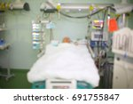 man in coma in the hospital icu ... | Shutterstock . vector #691755847