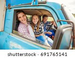 three friends traveling by car... | Shutterstock . vector #691765141