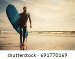 portrait of surfer man with... | Shutterstock . vector #691770169