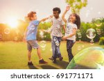 kid and friends in... | Shutterstock . vector #691771171