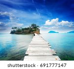 bridge to agios sostis island ... | Shutterstock . vector #691777147