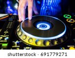 dj mixes the track in the... | Shutterstock . vector #691779271