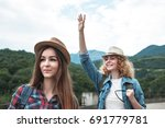 two girls in hats traveling and ... | Shutterstock . vector #691779781
