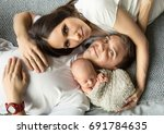 happy family with new born baby   Shutterstock . vector #691784635