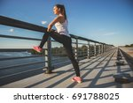 stretching after workout.... | Shutterstock . vector #691788025
