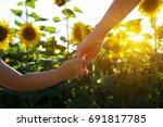hands of mother and son holding ... | Shutterstock . vector #691817785
