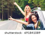 two laughing young girlfriends... | Shutterstock . vector #691841089