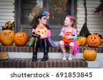 halloween sisters sitting on... | Shutterstock . vector #691853845