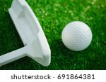 golf ball with putter on green... | Shutterstock . vector #691864381