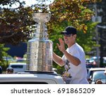 Small photo of DARTMOUTH, CANADA - AUG 7, 2017: Cole Harbour native Sidney Crosby, captain of the of the Stanley Cup champion Pittsburgh Penguins with the Cup as the grand marshal for the 122nd Natal Day Parade.