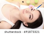 hands of cosmetologist making...   Shutterstock . vector #691873321
