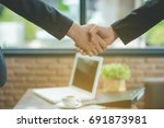 Small photo of Business people shaking hands, finishing up a meeting, shaking hands success deal, Young businesswoman going to make handshake with a businessman -greeting, dealing, merger and acquisition concepts