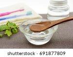 coconut oil pulling   image of...   Shutterstock . vector #691877809