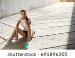 confident and fit female runner ... | Shutterstock . vector #691896205