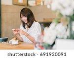 beautiful asian girl taking... | Shutterstock . vector #691920091