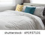 colorful pillows on white bed... | Shutterstock . vector #691937131