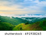 sunset on mountain with fog... | Shutterstock . vector #691938265