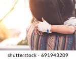 sick child girl's hand with... | Shutterstock . vector #691943209