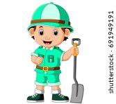 cute hiker boy holding shovel | Shutterstock . vector #691949191