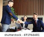 business people shaking hands ... | Shutterstock . vector #691966681