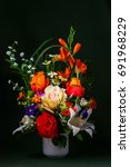 a vase of pseudo rose and lily... | Shutterstock . vector #691968229
