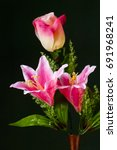 a vase of pseudo rose and lily...   Shutterstock . vector #691968241